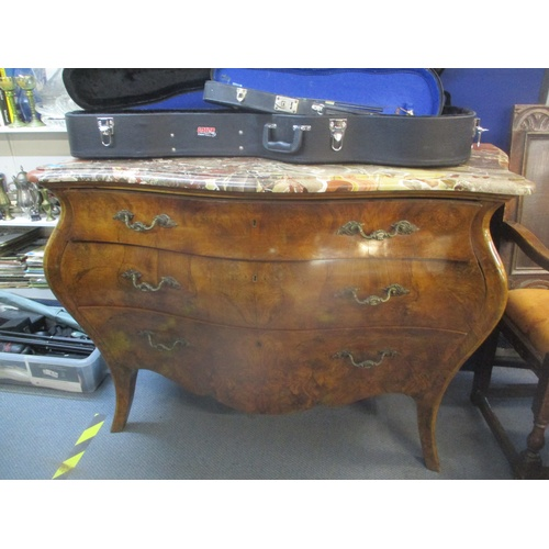 5 - A late 20th century reproduction of a Louis IV walnut bombe commode with a mottled marble top over t...