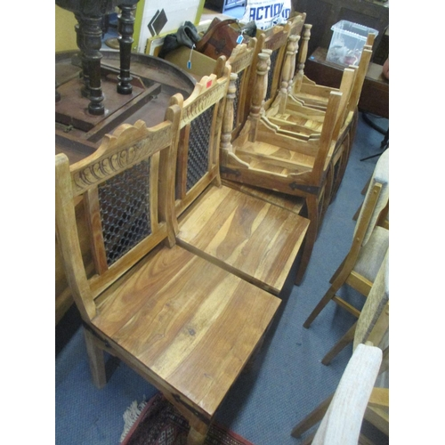 42 - A set of eight hardwood chairs with lattice iron panelled back and solid seat Location: C...