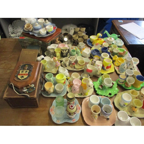 49 - A collection of vintage ceramic, metal, wooden and glass novelty egg cups, miscellaneous egg cup tra...