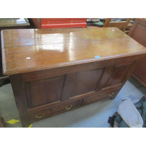 6 - An 18th century oak panelled coffer having a hinged top and two drawers, 32 1/4