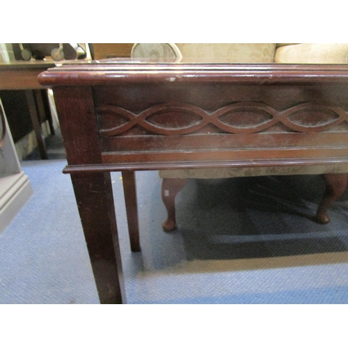 50 - A mahogany side table with string inlay and crossbanded top with moulded edge, blind fretwork frieze...