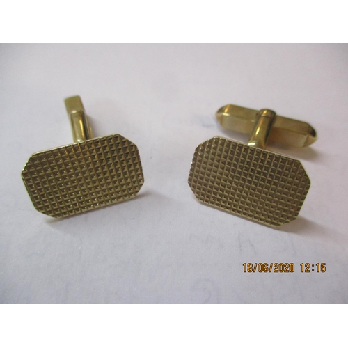 10 - A pair of 9ct gold cuff links with engine turned decoration to the tablet, 8.4g Location: CAB...
