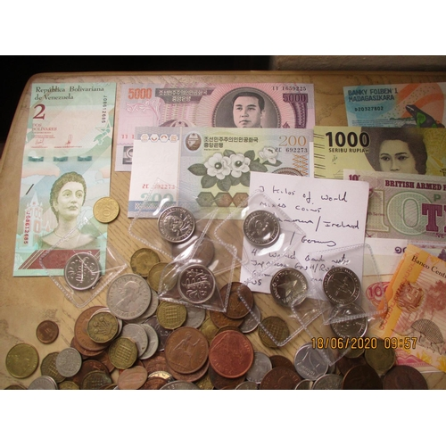 19 - A large quantity of loose worldwide coins to include Crowns, together with approximately forty world...