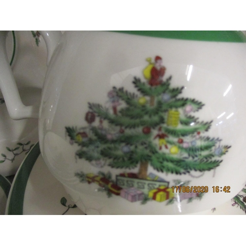 28 - A Spode Christmas Tree pattern dinner service to include a teapot, a candlestick, a cake stand, teaw...
