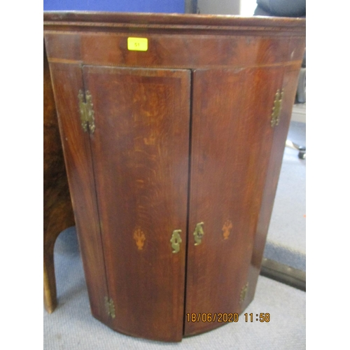51 - An early 19th century inlaid oak bow front corner cabinet.  Location: FSR...