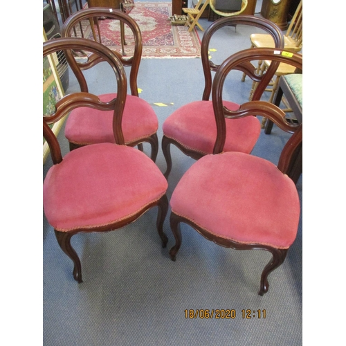53 - A set of four mahogany kidney backed dining chairs with pink upholstered seats Location: C...