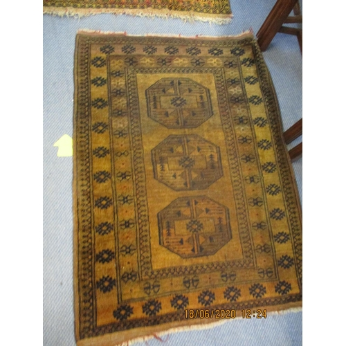 58 - Two yellow ground rugs with elephant gull medallions Location: FR...