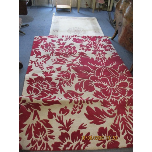 61 - A modern Chinese carpet and a modern red and beige floral rug.  Location: RAB...