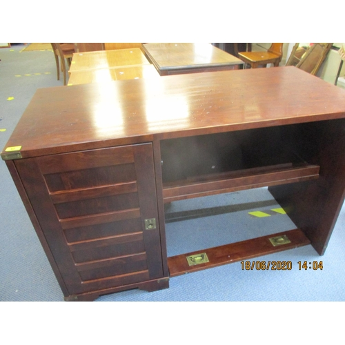 62 - A modern mahogany stained desk, in need of attention with campaign style handles and corner brackets...