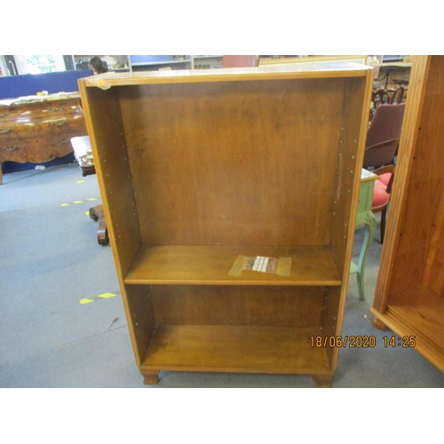 63 - A walnut bookcase with one shelf, together with a beech single bed frame, a mid 20th century walnut ...