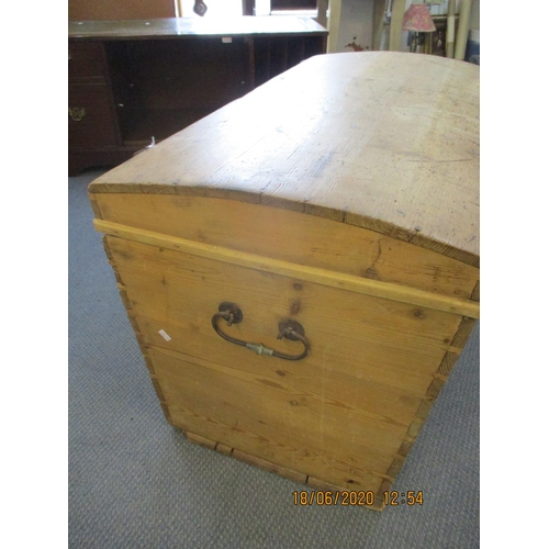 67 - An early 20th century pitch pine and domed travelling trunk with side handles, 20