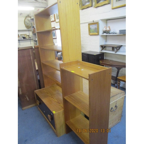 68 - A contemporary pine side unit having five shelves above two painted drawers, together with a modern ...
