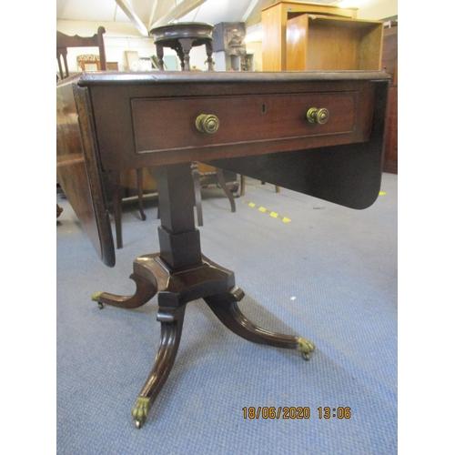 69 - A 19th century mahogany Pembroke style table on quatrofoil base, 28