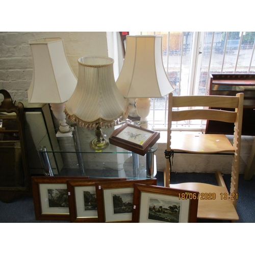 72 - A mixed lot comprising a glass television stand, three late 20th century table lamps to include a pa...