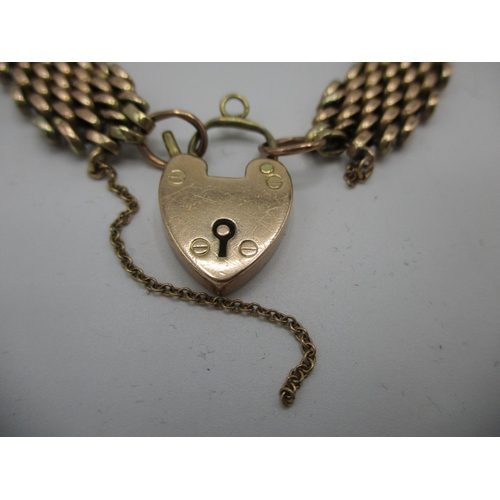 44 - A yellow metal panther link bracelet fitted with 9ct gold padlock and safety chain, 6 3/4