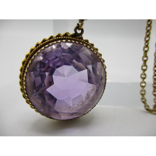 45 - A 9ct gold neck chain with yellow  metal pendant with one oval bezel cut amethyst and one round beze...