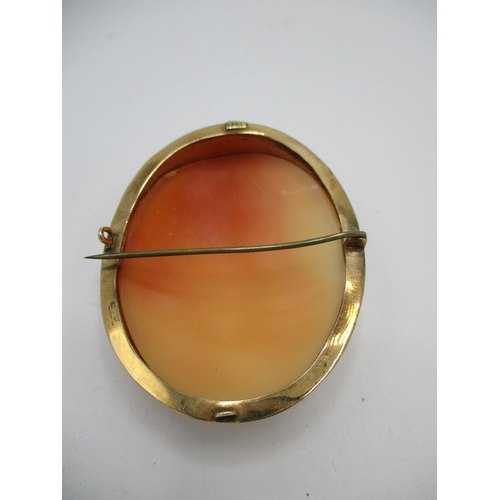 47 - A 9ct yellow gold framed Victorian cameo brooch with oval shell cameo depicting a Grecian scene with...