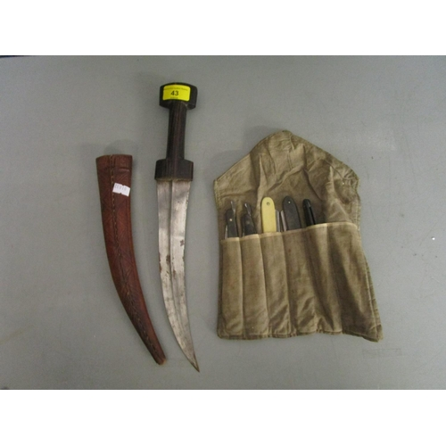 43 - A group of five cut throat razors in cloth slip case, and a Turkish Ottoman dagger in leather sheath...