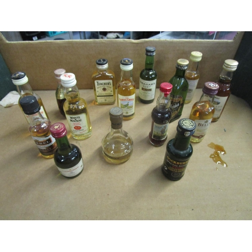 44 - A small selection of alcoholic miniatures to include Teacher's Highland Cream Scotch Whisky Location...