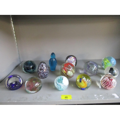 46 - A collection of 13 glass paperweights, mainly Isle of Wight, and a 1981 Selkirk glass weight commemo...