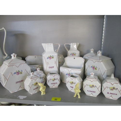 92 - A set of porcelain storage jars with covers, wall hanging salt holders, jugs and other kitchenalia L...