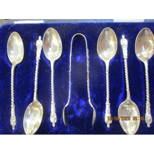 93 - A cased set of six silver apostle spoons and matching sugar tongs, total weight 94.5g Location: LAB...