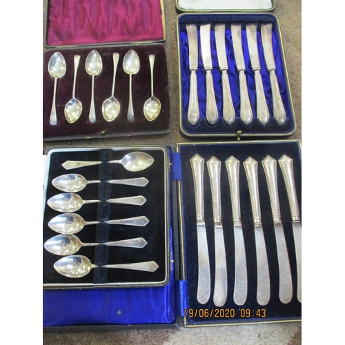 95 - Four cased sets of silver flatware to include two cased sets of six engine turned butter knives and ...