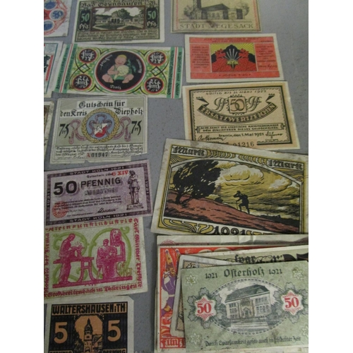 90 - A quantity of Russian and German emergency currency from the 1920s to include those with designs, al...