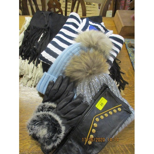 21 - Mixed clothing, mainly new with tags, to include modern ladies woollen hats and leather gloves Locat...