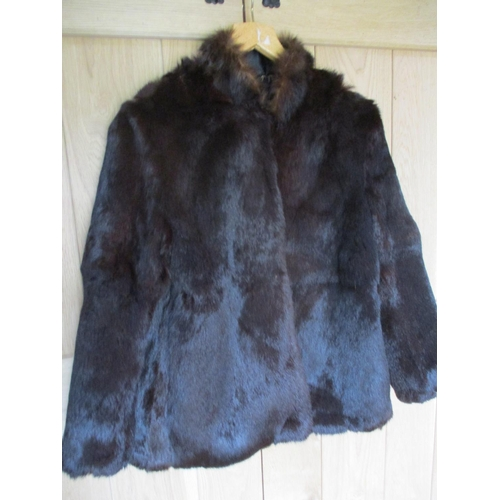 16 - A late 20th century Chinese black satin mandarin jacket with a reversible dark brown rabbit fur lini...
