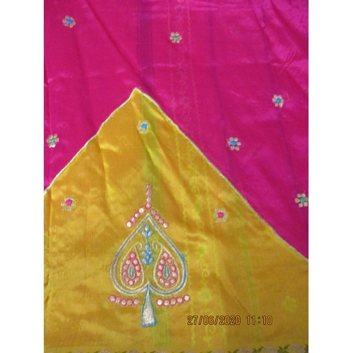 14 - A fuchsia and mustard yellow sari having a gold and coloured thread embroidery, 43