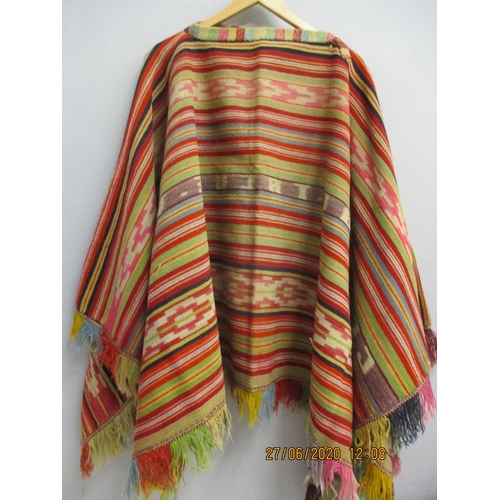 30 - A multi coloured, handwoven Peruvian wool poncho, 29