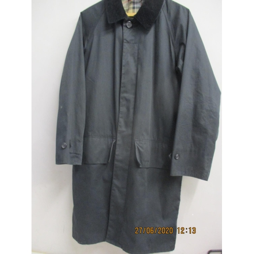 31 - A gents Barbour black lightweight three quarter length rain mac, approximately 40