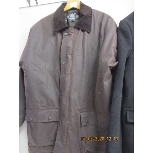 32 - A Jackdaw gents wax cotton coat in brown, size M, approximate 46