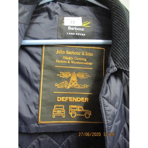 33 - Barbour Landrover Defender- A lightweight padded jacket in navy, size L, approximately 38