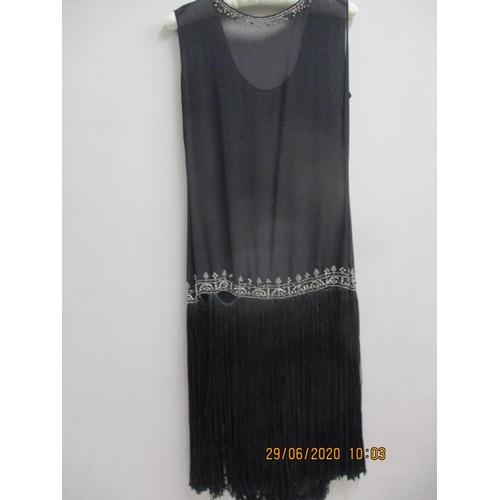 34 - A 1920s black Charleston dress with diamante bead detail having a black fringe, measurements approxi...