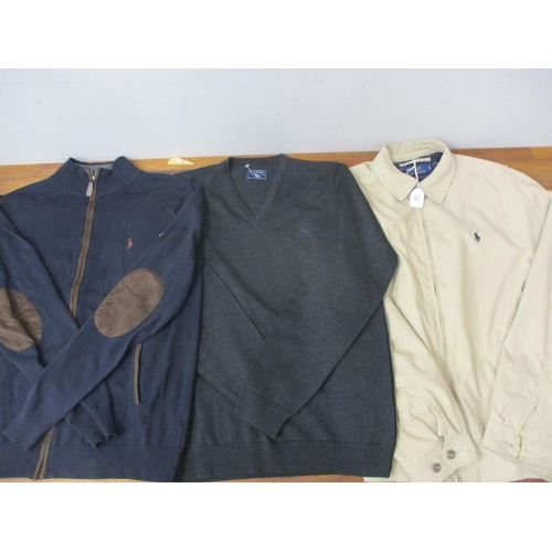 35 - Polo Ralph Lauren- A lightweight tan sports jacket with horse and polo rider logo to the lapel, size...