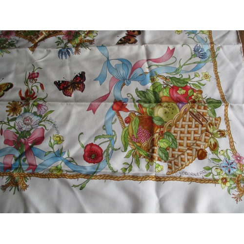 8 - Gucci - a 1970s F Accomero for Gucci silk scarf having a symmetrical floral, butterfly and fruit des...