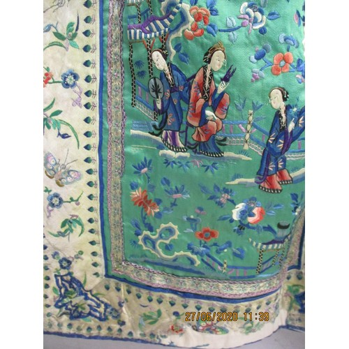 19 - A late 19th Century Chinese silk embroidered wrap-around apron skirt having a cotton/hemp waist band...