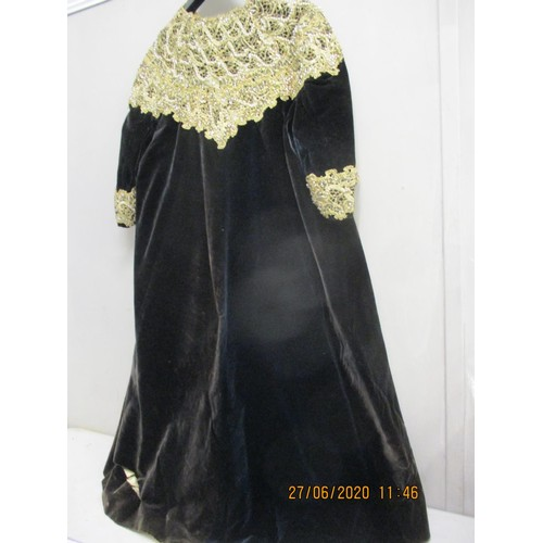 36 - An early 20th century black velvet opera coat, label Switzer, Dublin, having a gold thread, lace and...