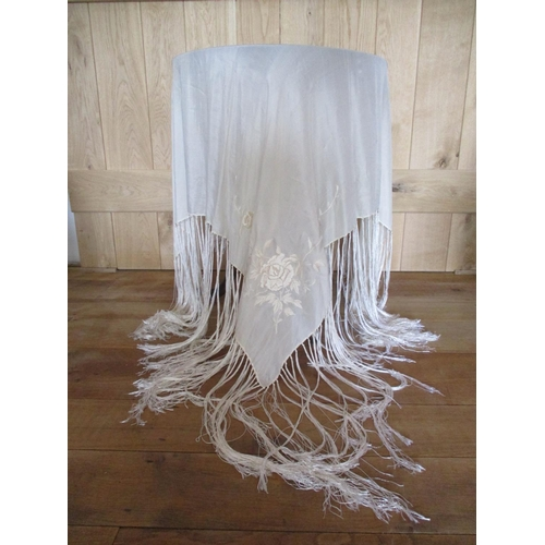 5 - A late 1920s cream silk and embroidered piano shawl with tassels...