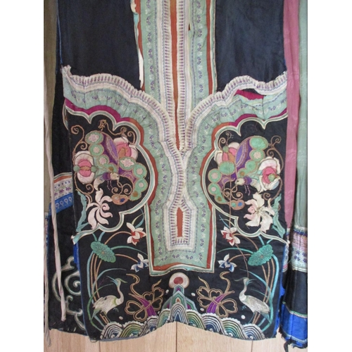 22 - A 19th century Chinese silk embroidered wrap around apron skirt having a cotton/hemp waistband, the ...