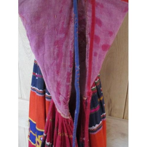 37 - An early 20th century ethnic Banjara handmade mirror skirt, in red, blue orange and yellow, measurem...