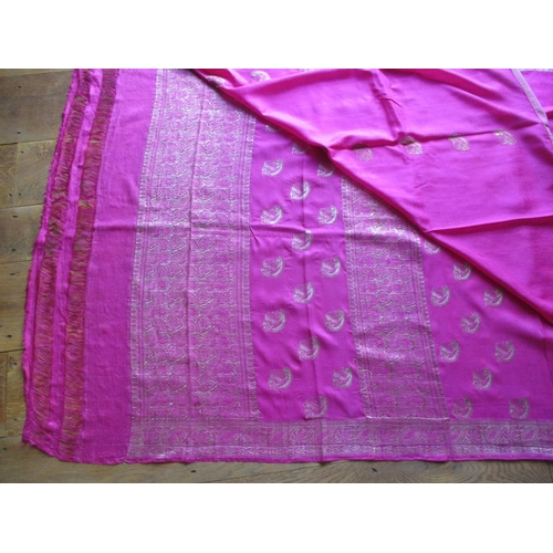 9 - An Indian fuchsia silk and gold coloured thread sari, A/F, measurements approximately 184