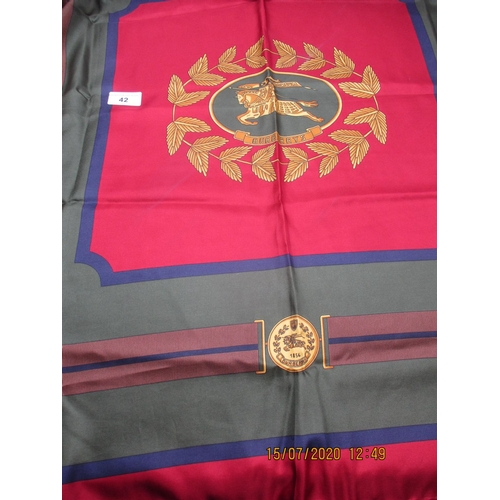 42 - A vintage Burberry Prorsum silk scarf having a central motif depicting a knight in armour on his ste...