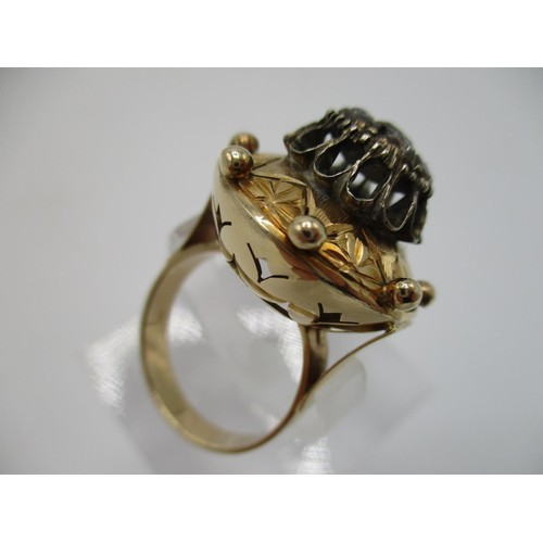 45 - A 18th century gold coloured metal and diamond ring, the domed top set with eight old mine cut diamo...
