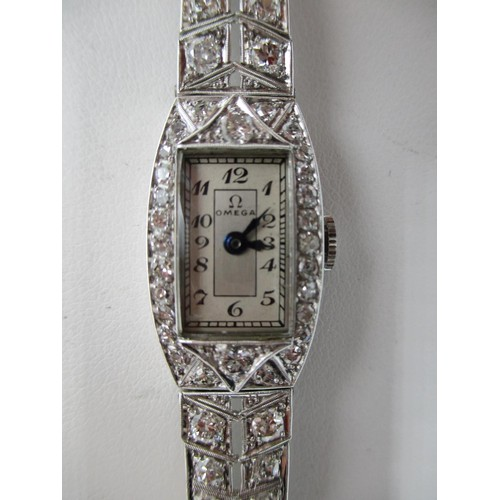 46 - An Omega white gold and diamond ladies wristwatch with rectangular dial with Arabic numerals, inset ...