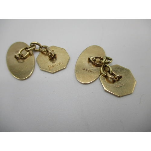 257 - A pair of 9ct gold chain link cufflinks with engine turned decoration, 7g...