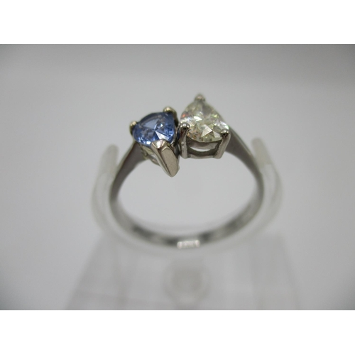 261 - A platinum diamond and sapphire ring set with two pear shaped stones, the sapphire with an Internati...