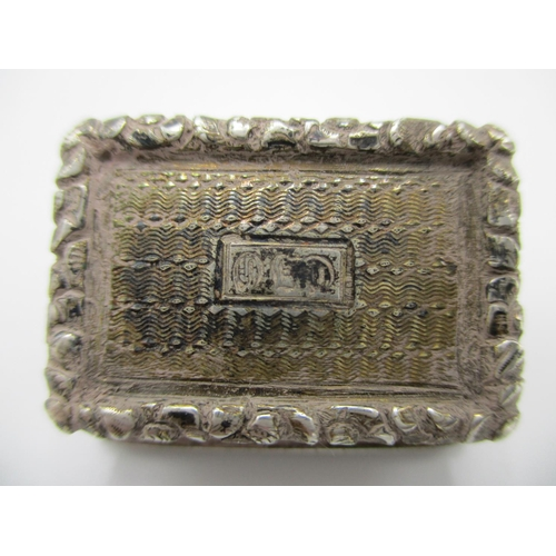 277 - A William IV silver vinaigrette possibly by Nathaniel Mills 1831 with a cast and applied leaf edge a...